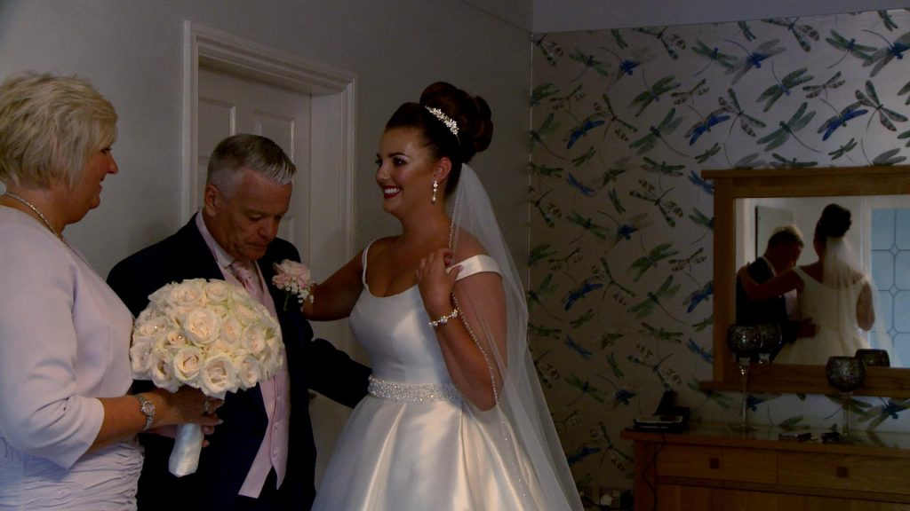 a video still of the brides dad reacting to seeing his daughter the bride for the first time