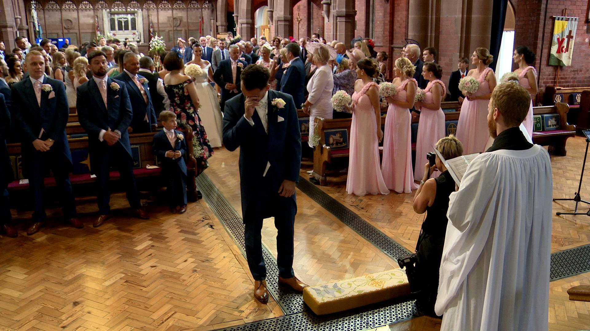 a groom gets emotional in church captured on video in the wirral