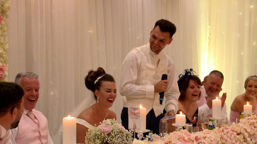 The groom makes the top table laugh out loud during his thornton hall wedding speech