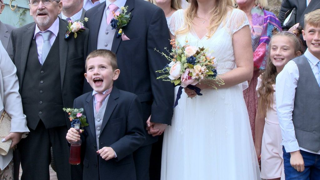 carter the page boy pulls a silly face for their wedding photographer Thomas Ellwood