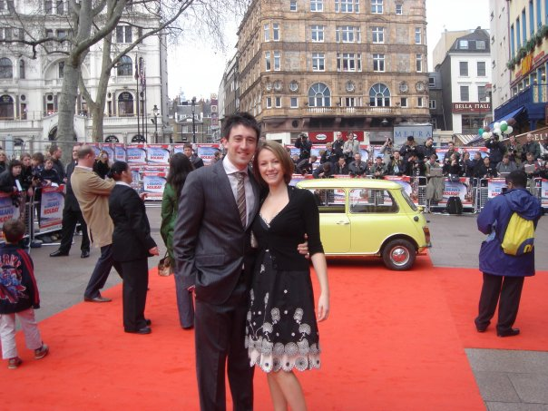 a couple stand on the red carpet at a film premiere in London