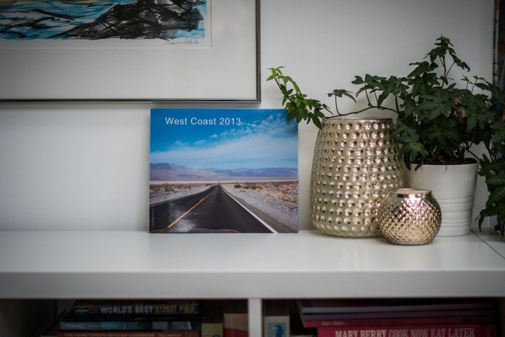 a holiday photobook sits proudly on a white ikea unit at home in Lancashire