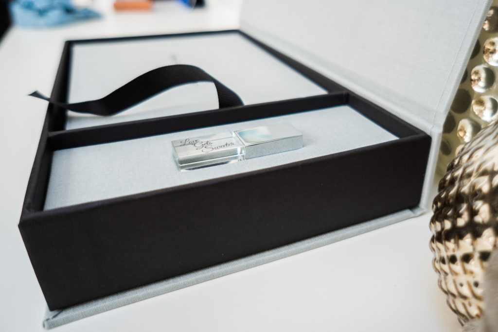 a close up photo of a personalise USB stick for a family film inside a box with an album