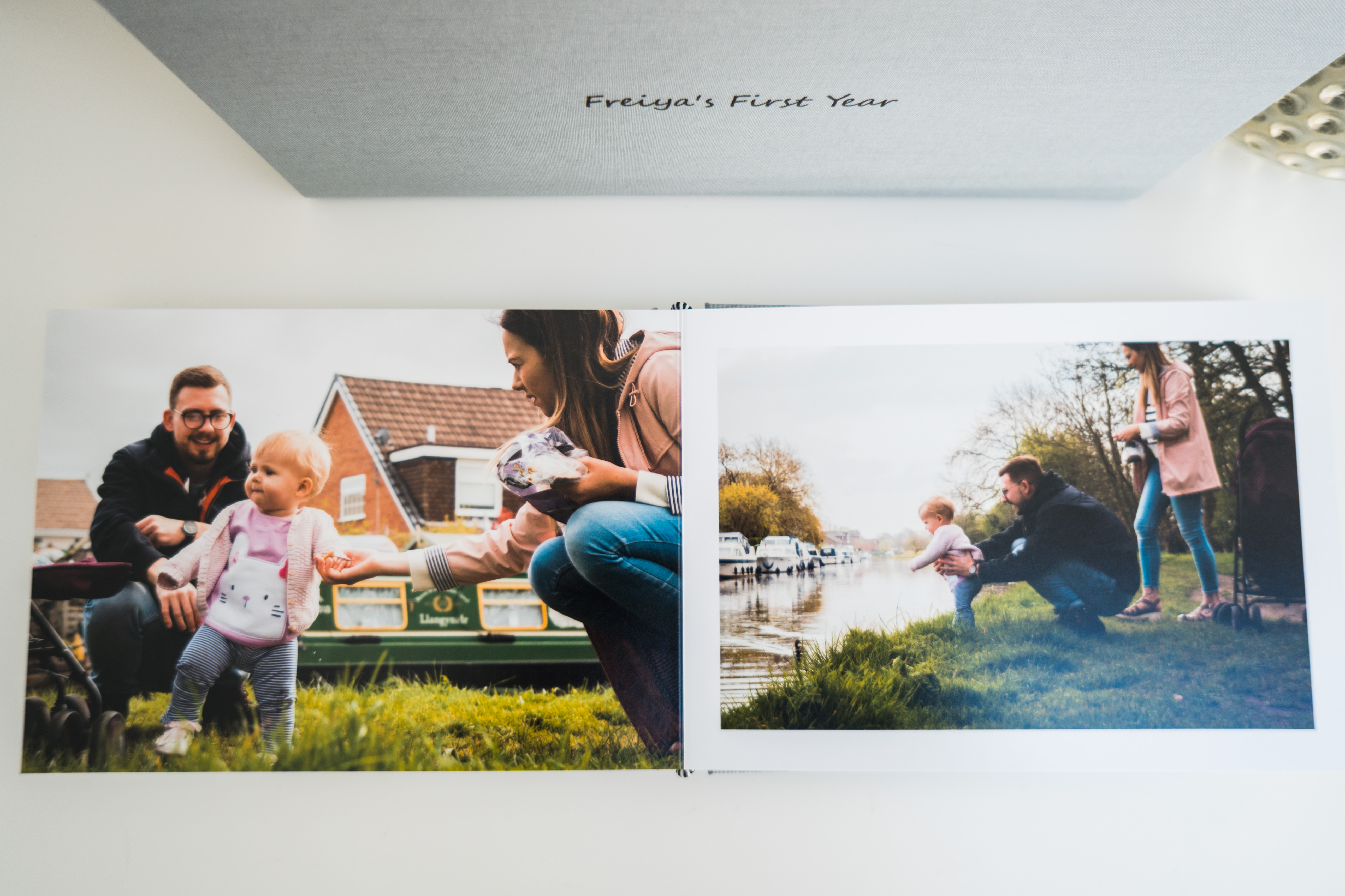 a photo from above of a family photo album open showing a documentary outdoor photoshoot in Lancashire by Love Gets Sweeter