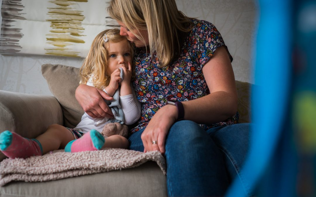 natural photo of mum kissing daughter during shoot in Yorkshire