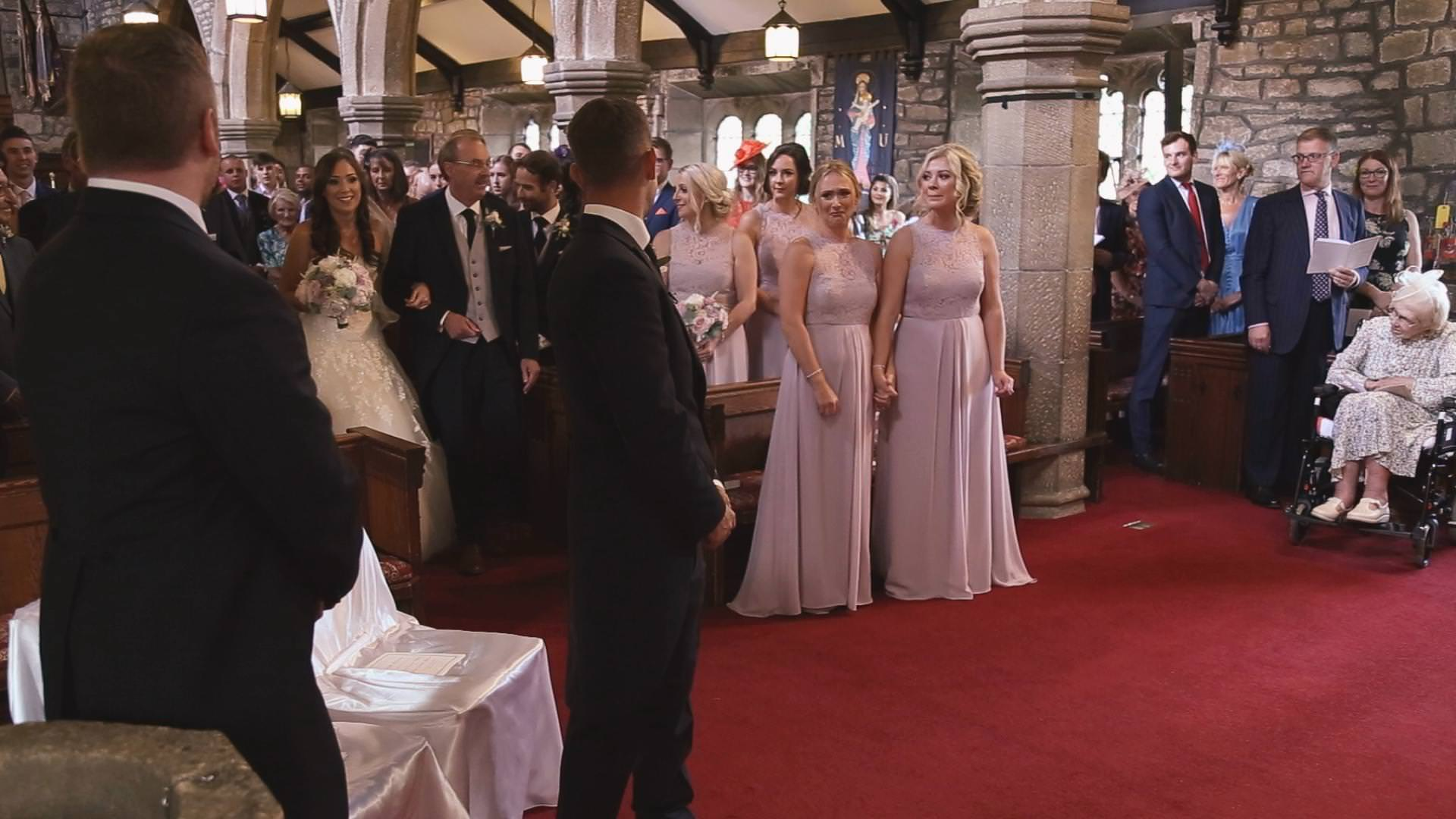 a wide video shot of a wedding at St Bartholomews and St John's Church