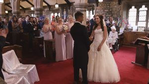 a wide video still of a bride and groom getting married at St Bartholomews and St John's Church in Lancashire