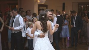 the bride and groom enjoy their first dance at mitton hall