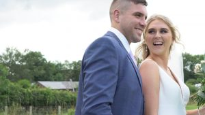 a video still of a bride laughing at her groom during their wedding photos in Lancashire