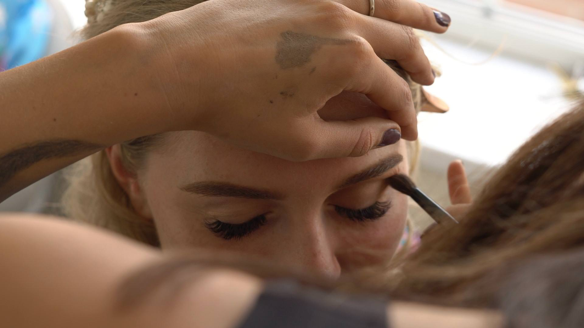 a close up of bridal eye make up being applied in Lancashire