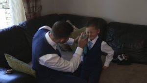a video still of a page boy having his hair sprayed in Lancashire