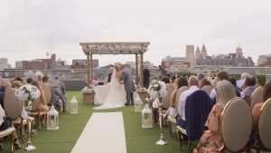 bride and groom kiss during outdoor ceremony at Eden the Shankly Hotel Liverpool