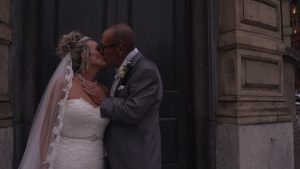 bride and groom kiss outside the Shankly Hotel in Liverpool