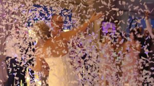 a white confetti canon is set off during the wedding first dance in liverpool
