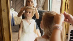 a cute flower girl getting a flower crown put on in liverpool