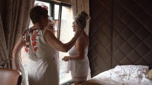 the brides mum and friend fuss over her at the Shankly Hotel