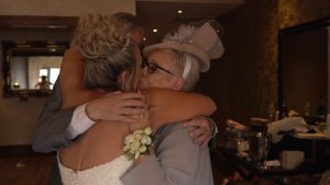 the bride gets a huge hug off her Mum and dad at the Shankly Hotel liverpool