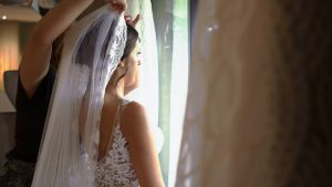 a close up video still of a bride having her veil put in at Moddershall Oaks