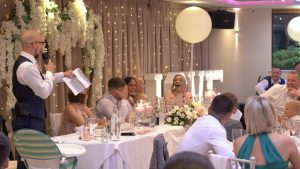 a wide video shot of a wedding reception and speeches at Moddershall Oaks