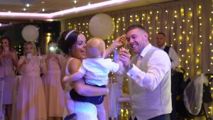 bride groom and son dance at their wedding at Moddershall Oaks