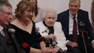 video still of a nan watching a wedding ceremony