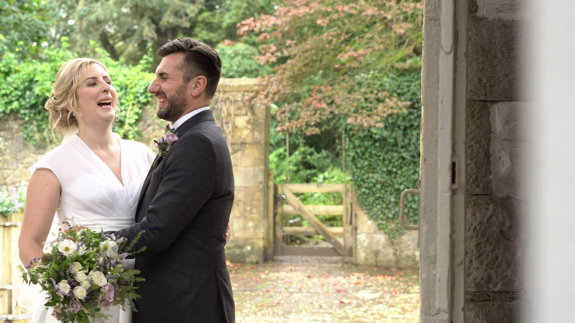 bride and groom laugh during video and photo couple portraits