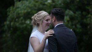 romantic moment on wedding video of bride and groom