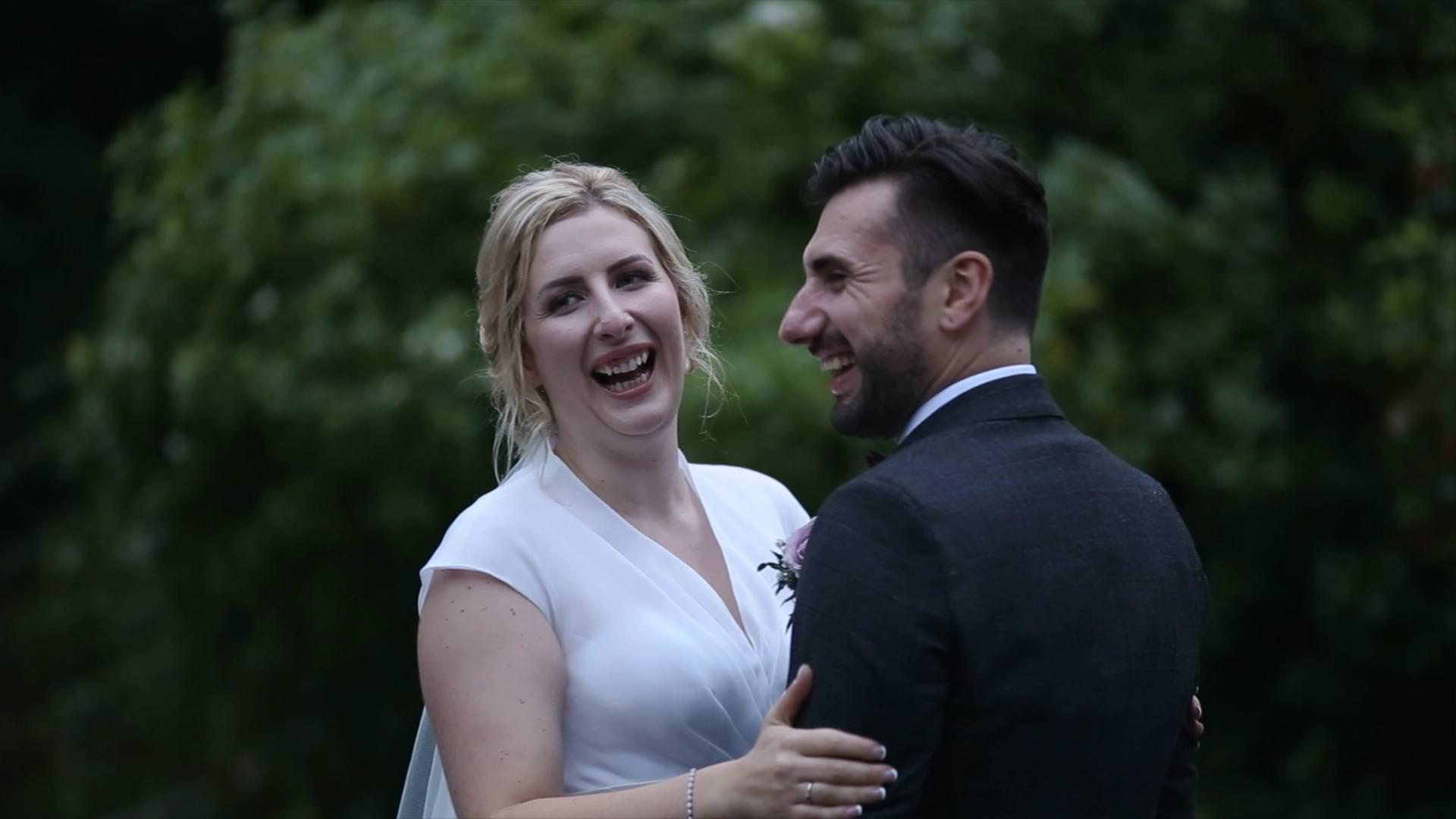bride and groom laugh at each other during video couple shots