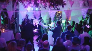 bride and groom dancing in white barn at Wyresdale