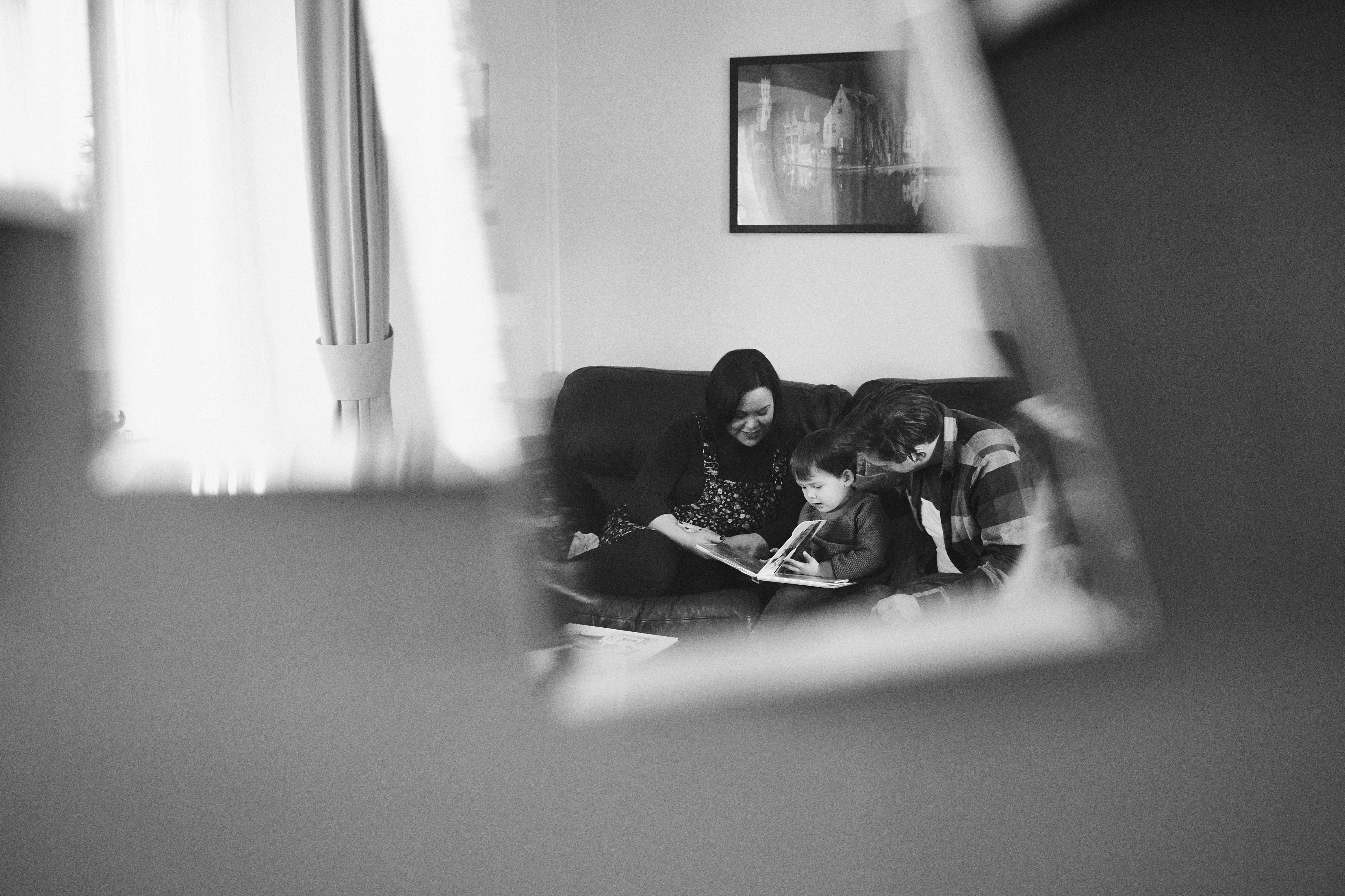 creative photo through mirror reflection of family reading at home