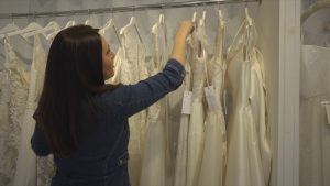 clare suzanne bridal shows wedding dresses on rack