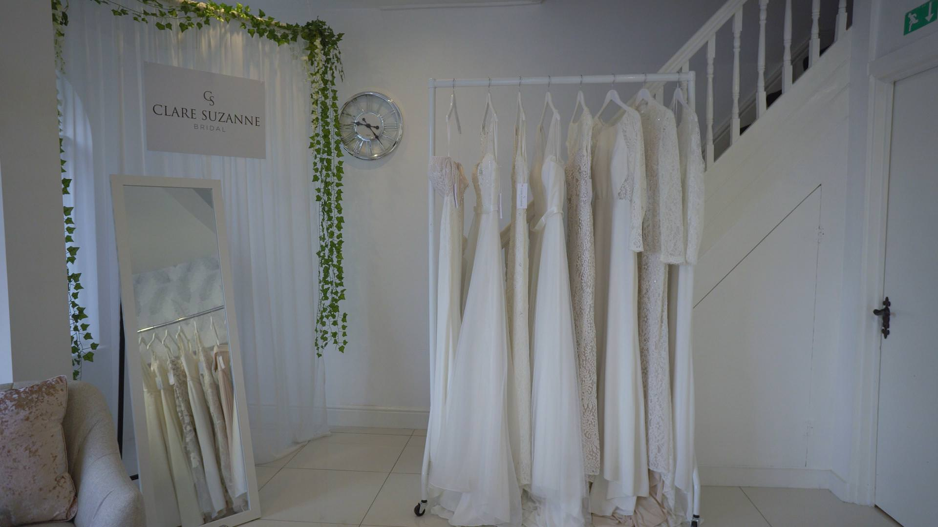 video still of bridal boutique dresses