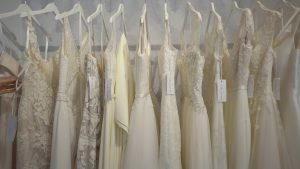 a wide shot of a row of wedding dresses in liverpool shop