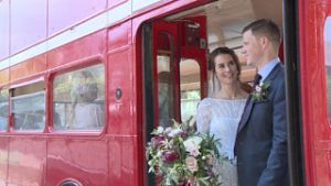bride and groom on a vintage red bus in cheshire