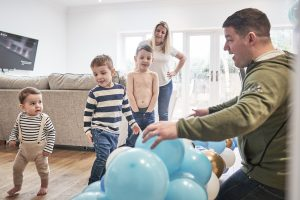 family fun with balloons in their cheshire home