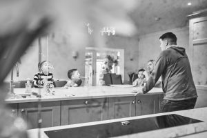 creative and fun photo of family in their kitchen at home