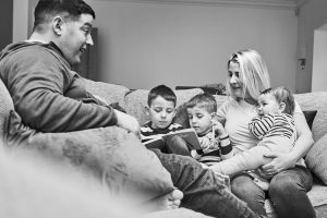 black and white family portrait at home in cheshire
