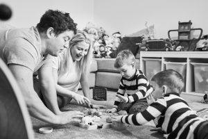 family play hungry hippos during photoshoot in cheshire