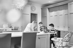 black and white documentary photo of family in kitchen