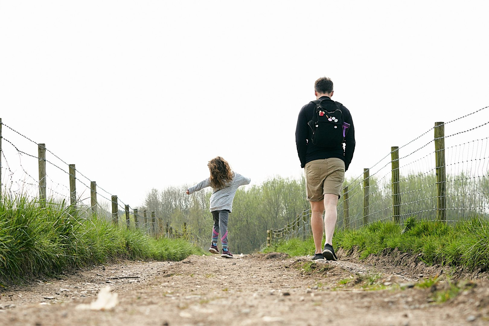 dad and daughter walk a country path in burscough