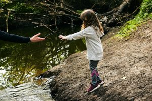 girl reaches out for dads hand in lancashire