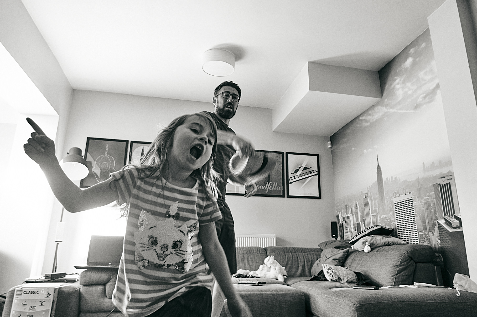 documentary family photo of girl and dance in living room
