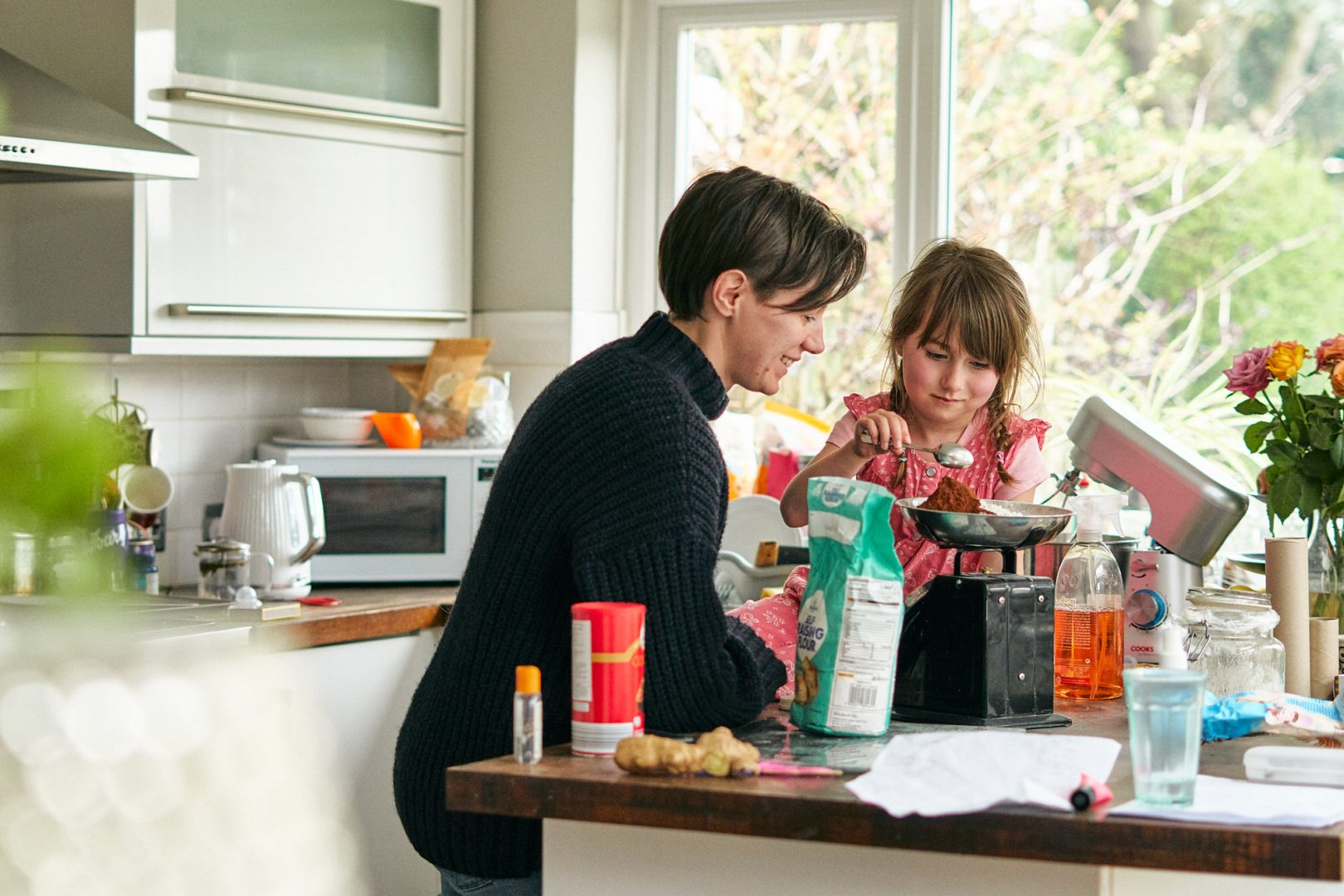 self portrait of mum and daughter baking at home during lockdown