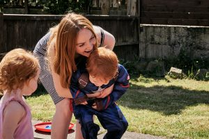 mum plays with son in fun family shoot