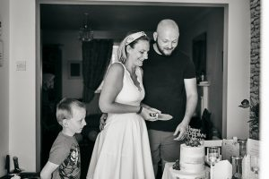 family pretend to cut wedding cake during lockdown