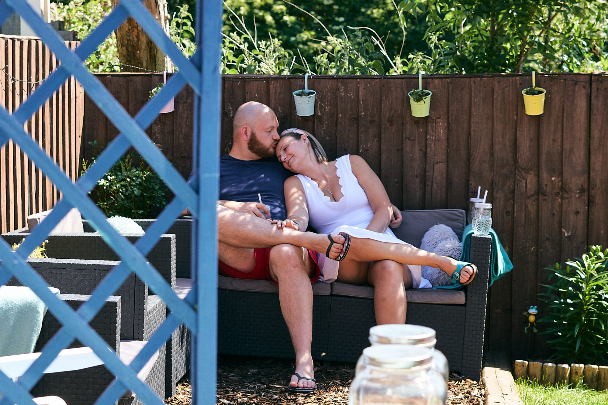 couple relax outside in their family garden