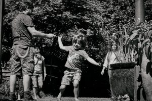 photo of family playing outdoors in garden