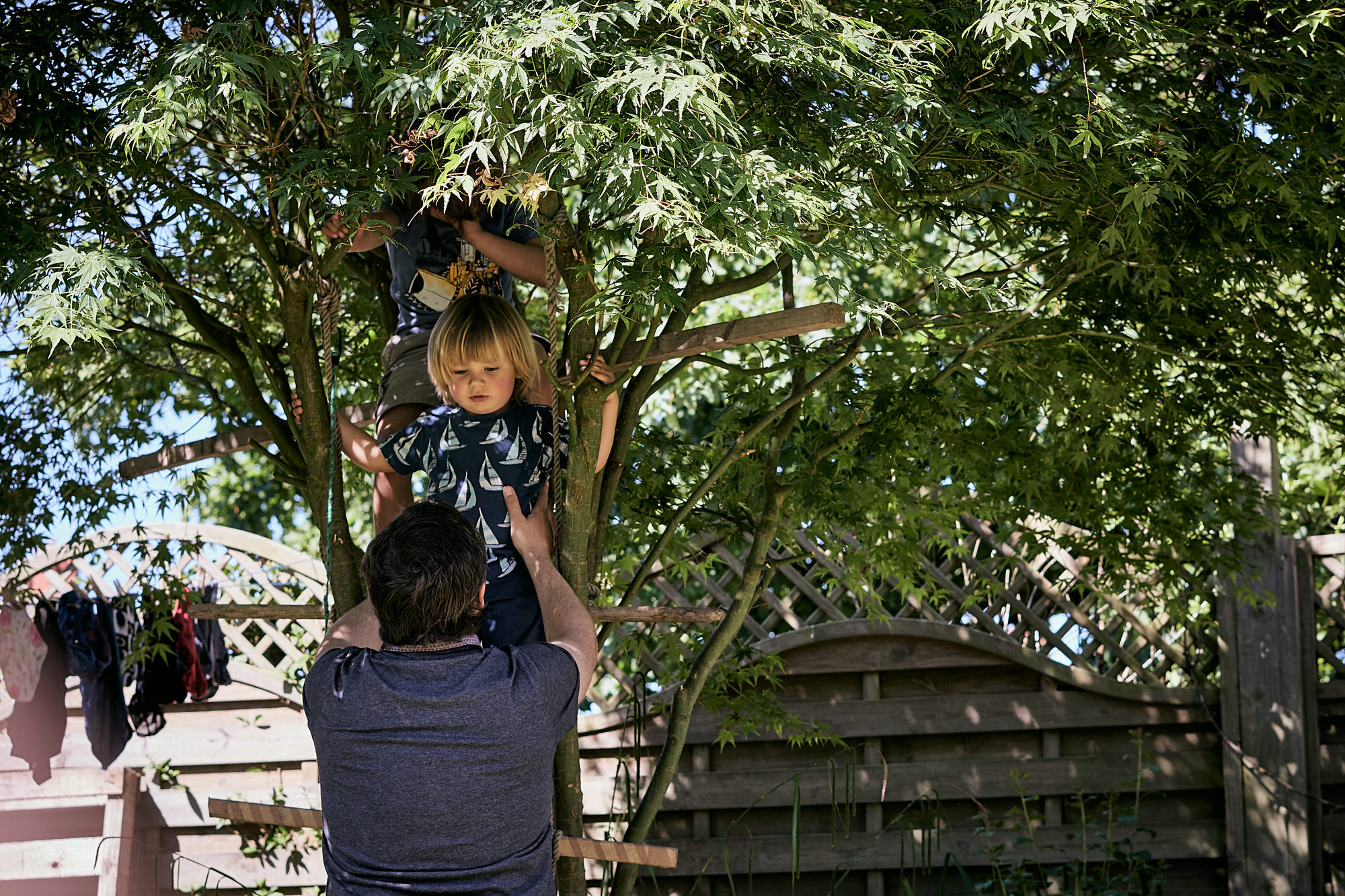 child and dad playing in tree in burscough