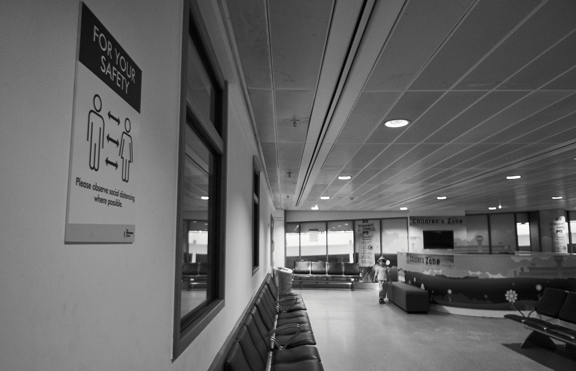 empty terminal at manchester airport during coronavirus