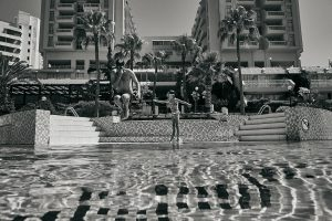 dad and daughter jump in swimming pool at Fantasia Kusadasi
